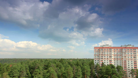Movement of clouds over the forest, high-rise buil Footage