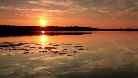 Man enters the lake at sunset Stock Video Footage