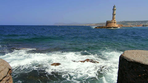 The sea and the old lighthouse Stock Video Footage