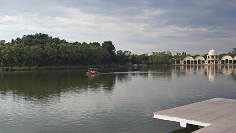 Harbin. Boat floating in a pond Stock Video Footage