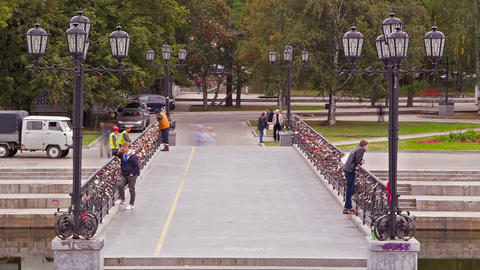People walk across the bridge. Time Lapse Stock Video Footage