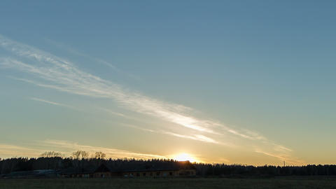 Sunset over the field with a barn. Stars appear. T Stock Video Footage