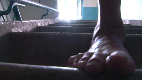 Bare feet are on the stairs Stock Video Footage