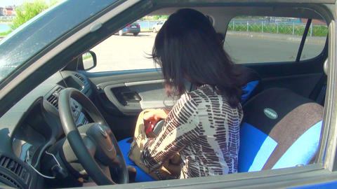 Brunette in the car moves makeup Stock Video Footage