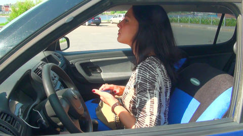Brunette in the car moves makeup Footage