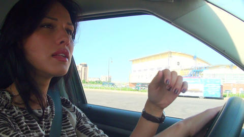 Brunette driving the car Stock Video Footage