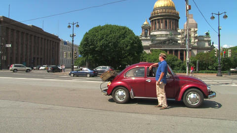 The driver and the girl by car beetle Stock Video Footage