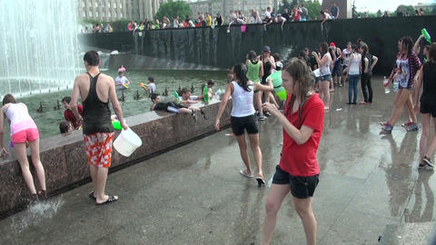 A crowd of people drenched in water Footage