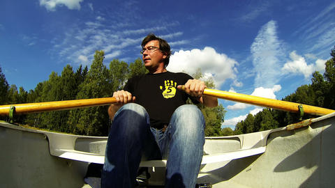 The man on the boat with oars Stock Video Footage