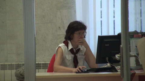 A woman in an office behind a computer Stock Video Footage