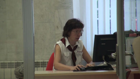 A woman in an office behind a computer Footage
