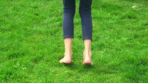 A teenager jumps on the grass Stock Video Footage