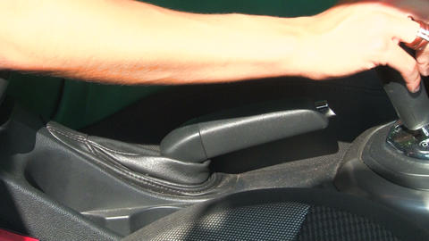 Handbrake in the car. A woman's hand Stock Video Footage