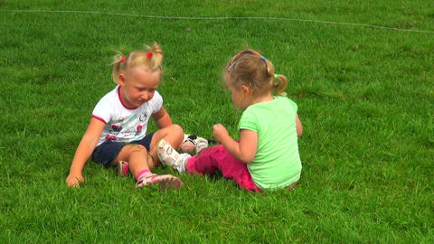 Two Little Girls Playing In The Grass stock footage