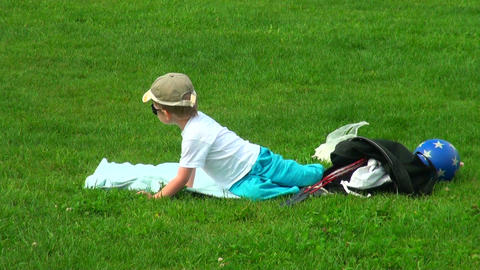 Little boy on the grass Footage