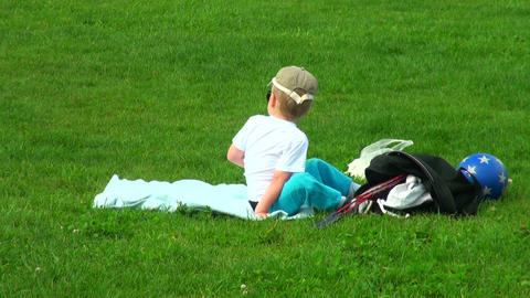 Little boy on the grass Stock Video Footage