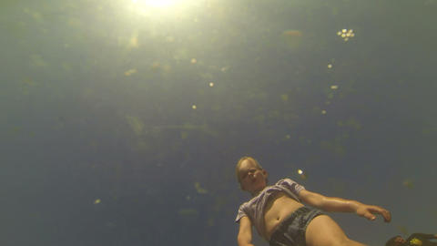 Girl looks through the water Stock Video Footage