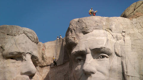 Men rappelling Mount Rushmore National Memorial Stock Video Footage