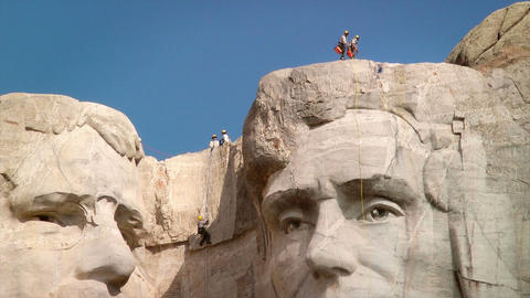 Men rappelling Mount Rushmore National Memorial Stock Video Footage