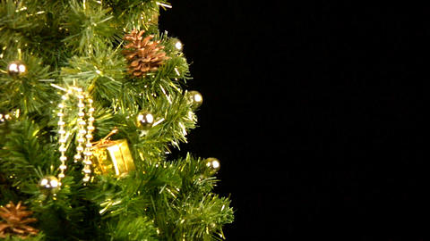 Green Christmas tree with gold ornaments rotate Footage