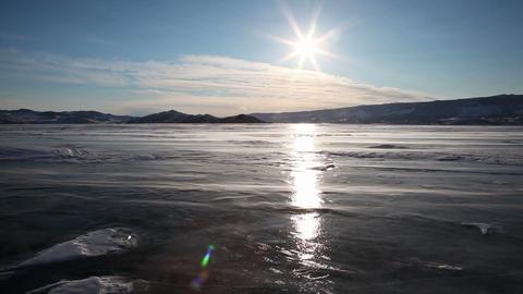 Drifting snow on Baikal lake during sunset Footage