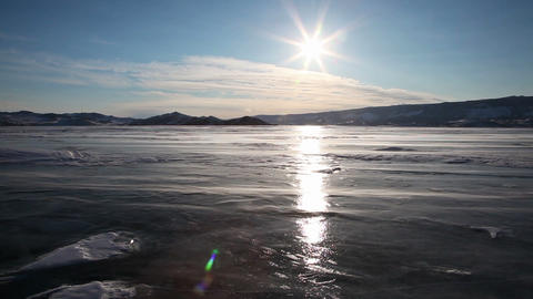 Drifting snow on Baikal lake during sunset Stock Video Footage