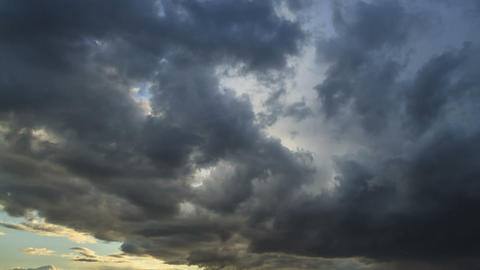 Storm clouds at sunset. Time Lapse Footage