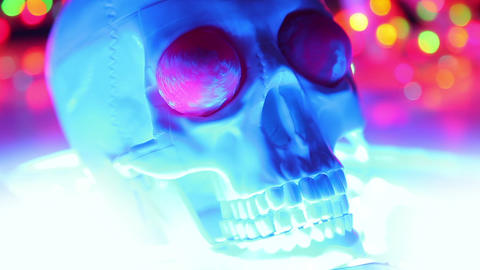 Skull on defocused background, halloween scary hea Footage