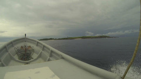 Boat driving to the island Stock Video Footage