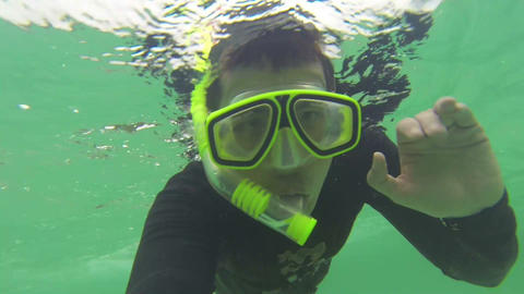 Diver saying hi to the footage Stock Video Footage