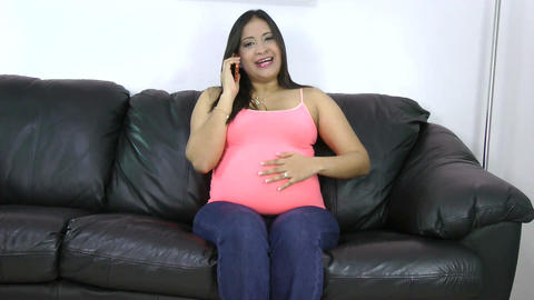 happy pregnant woman on the phone while sitting on Stock Video Footage