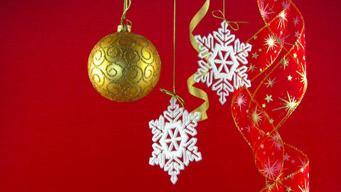 Golden ball, snowflakes and red ribbons Stock Video Footage
