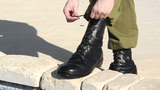 How To Tie Military Boots stock footage
