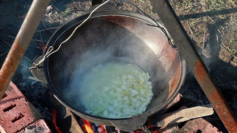 Process of preparation of traditional pilaf in a c Stock Video Footage