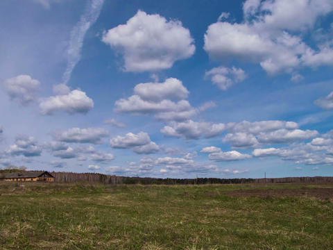 Clouds form over the field. Time Lapse. 4x3 Footage
