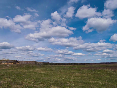 Clouds form over the field. Time Lapse. 4x3 Stock Video Footage