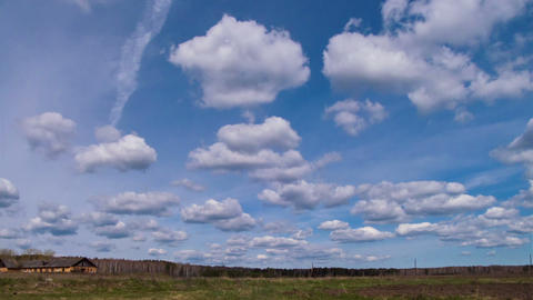 Clouds form over the field. Time Lapse Footage
