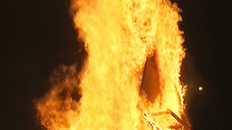 Fire pyre burning in the night handheld shot Stock Video Footage