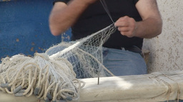 Fisherman repairs net Stock Video Footage