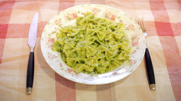 Italian pasta with pesto on table Footage