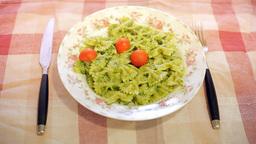 Italian pasta with pesto on table Stock Video Footage