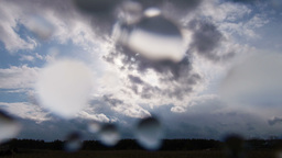 Rain and sun. Drops on the lens Stock Video Footage