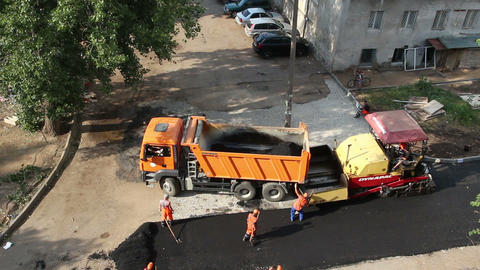 workers laid asphalt with special equipment - time Stock Video Footage