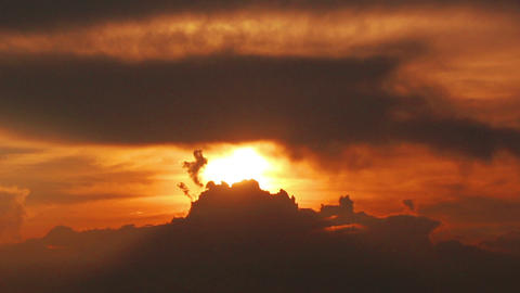 timelapse with dramatic red sunset on dark cloudy Stock Video Footage