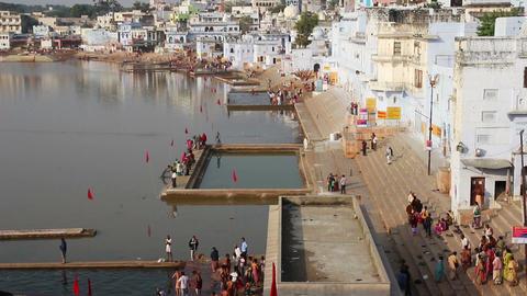 ritual bathing in holy lake Pushkar India - timela Stock Video Footage