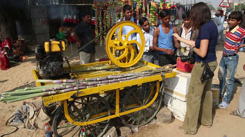 machine press fresh juice from sugar-cane in india Footage