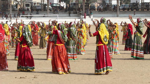 Indian girls in colorful ethnic attire dancing at Stock Video Footage