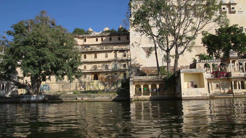 view from boat on lake and palaces in Udaipur Indi Footage