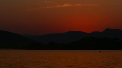 timelapse sunset on lake - Udaipur India Stock Video Footage