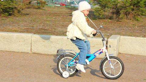 little girl on bicycle Stock Video Footage